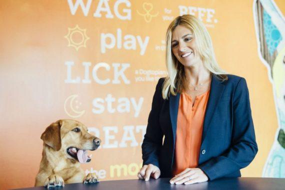 Woman and Dog at Dogtopia Counter