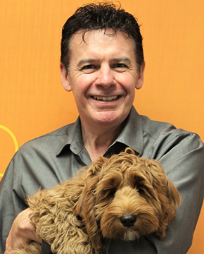 Neil Gill Holding Puppy