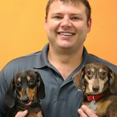 Aaron Mueller with Two Dogs