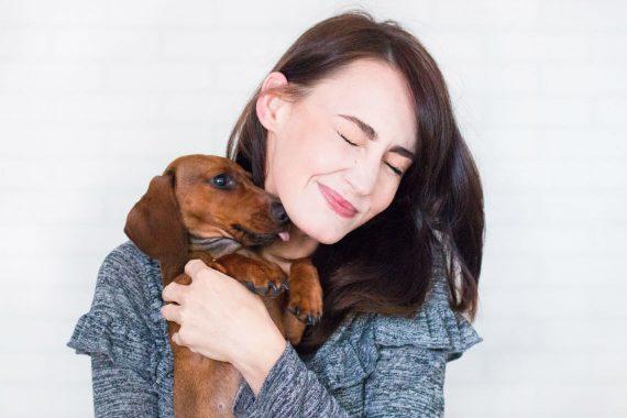 Girl holding a dachshund