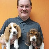 Chris Crosby holding 2 dogs
