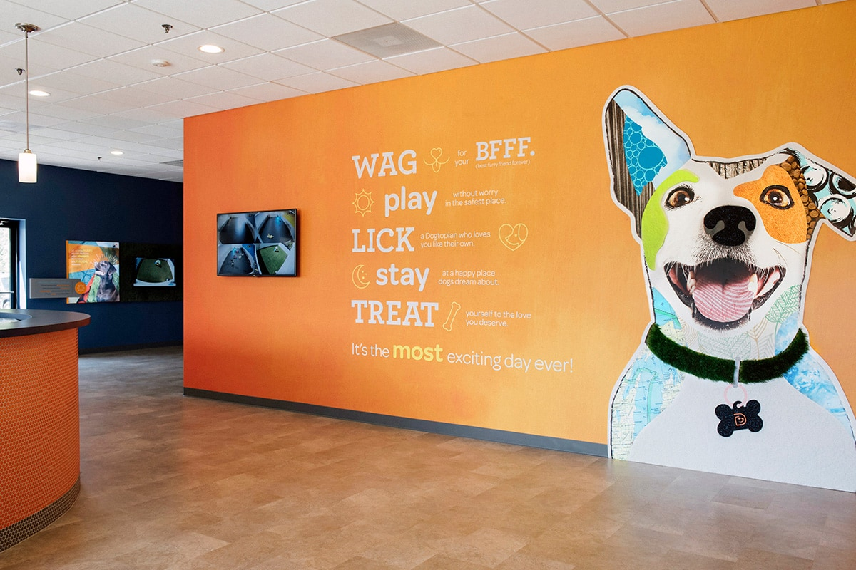 Welcome wall with the logo at Dogtopia lobby